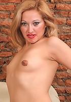 Mature blonde Rosa toying her swollen slit