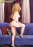 Busty mature brunette posing naked