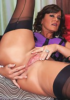 Mature mom plays with her boobs