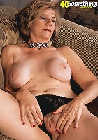 Sexy milf shows her big titties