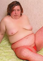 Mature plumper stripping in red pantyhose