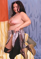 Charming mature fatty posing