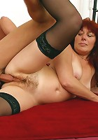 Black-stockinged mommy getting it from behind