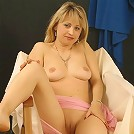 Mature blonde candy plays with her heavy melons