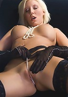 Aged blondie stuffs both of her holes with dildos