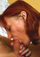 Aged redhead bouncing on top of young boy�s rod