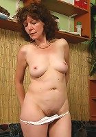 Juicy oldie shows her saggy tits and unshaven twat