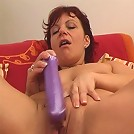 Mature hooker enjoying a deep dildo penetration