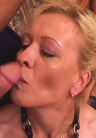 Slutty granny servicing three huge cocks