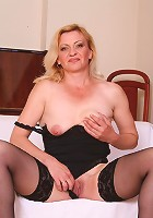 Sassy blonde mature Eliza jerking off two cocks and trying to swallow all of the fresh jizz