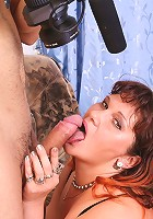 Big tit mature Denise kneading her huge boobs and impaling her pussy on a huge meaty dong