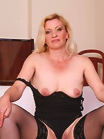 Blonde mature Eliza is alternately jerking off a huge cock and sucking another one in this hot movie