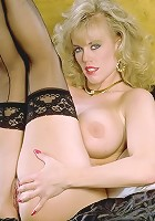 Hot Mature Bombshell Exposing Big Tits and Shaved Pussy