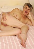 Granny sure loves to spread her clit for you