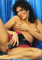 Outrageously horny mature Vera kneads her full breasts while dipping a dildo into her gash
