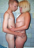 Hefty mature blonde with a huge ass joins a younger guy in the shower and gets it on