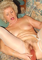 Horny grannies Francesca and Erlene stripping off their clothes and sharing a huge dildo