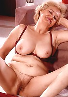 Grey haired mature model strips off to play with her sagged boobs and experienced snatch live