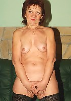Hot wrinkled redhead Paula doing a little live show by exposing her flabby butt and pussy
