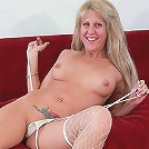 Nasty cock starved matured mom spreads wide on the couch wanting to be fucked