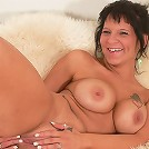 Dark-haired lustful mom undressing exposing her naked pleasure starved body
