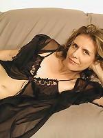 Kinky brunette mstured slut in her nighties teasingly seducing for the camera
