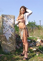 Blonde older babe exposing big tits and sexy body in outdoor pictorial session