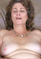 Curly brunette granny dildo fucking her unshaved pleasure hole
