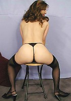 Mature brunette bending over to expose her tight ass.