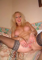 Slutty mature blonde flirting and rubbing her clit.