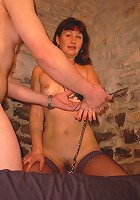 Chained mature redhead pumping a big cock in her hot mouth!