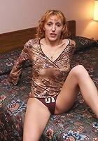 Older blonde bitch bending over to spread her smooth-shaven slit!