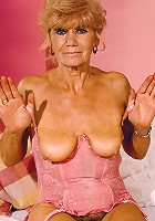 Blonde granny in sexy corset flaunting bushy box