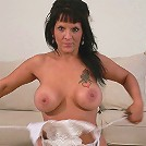 Sassy brunette mature flaunting huge hooters