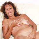 Mature whore plugging her hairless hole with a finger