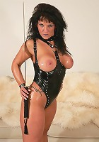 Mature dominatrix rubing her pussy with a samurai sword