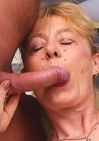 Experienced older babe Maria slurping a cock and jumps on top of it to take it in her bushy box
