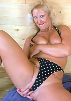 Blonde, heavyweight granny showing off huge assets