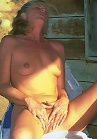 Mature blonde getting hot in the patio