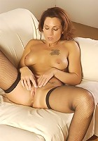 Stockings mommy in revealing pussy display