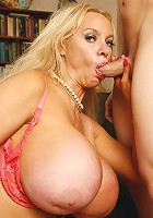 Busty mature pornstar Sexy Vanessa wowed a younger guy with her enormous fun bags
