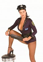Sexy mature Vanessa Videl posing in a sexy uniform and unbuttons it to unleash her boobies
