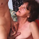 Hot mature Stephanie gives off a toothless blowjob and gets cum hosing all over her sagged tits