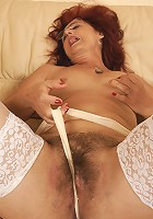 Kinky hairy mama fisted by a hot babe