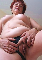 Horny mature slut sucking on cock and playing