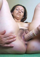 Horny mature Germaine loves playing with herself