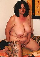 Big titted mature woman loves to play with herself
