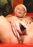Kinky mature nympho fisting herself