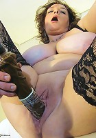 mature slut with the big boobies plays alone