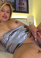 Mature housewife playing with her huge rubber friend